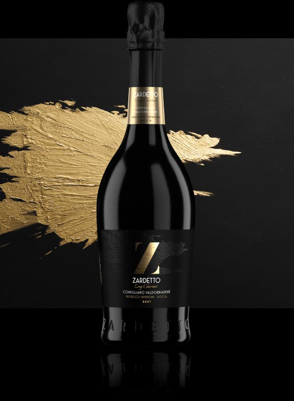Bottle of Prosecco Long Charmat photographed in front of it's artwork